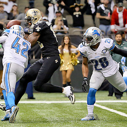 Dec 21, 2015; New Orleans, LA, USA; New Orleans Saints wide receiver Marques Colston (12) is hit by Detroit Lions strong safety Isa Abdul-Quddus (42) drawing a penalty for a hit to helmet during the fourth quarter of a game at the Mercedes-Benz Superdome. The Lions defeated the Saints 35-27. Mandatory Credit: Derick E. Hingle-USA TODAY Sports