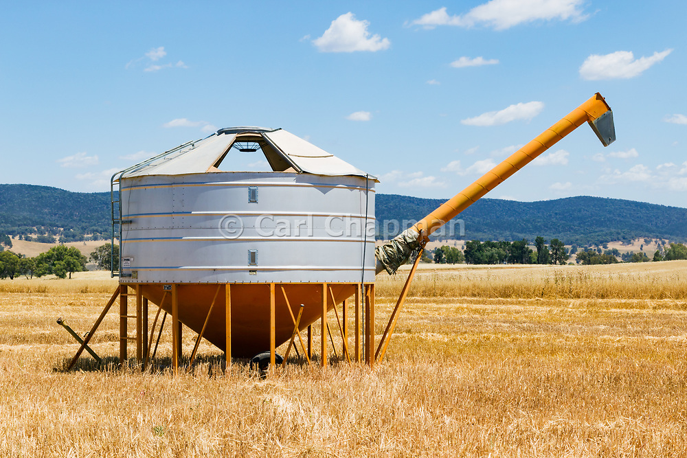 Mobile field bin grain silos in paddock after wheat harvest near Toogong, New South Wales, Australia <br /> <br /> Editions:- Open Edition Print / Stock Image
