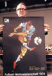 Hermann Neuberger, President of the FIFA Organising Committee, holds up the official poster of the 1974 World Cup Finals