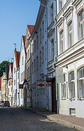 Tallinn, Estonia -- July 23, 2019. Photo looks down a side street with shops , apartments and stores Tallinn, Estonia.