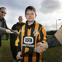Young Adam Gleeson ,Dal gCais all set for the Hurling School of Excellence which will run from 18th to 21st March at St Flannans College and is run by the Ennis Hurling Development Group.Also pictured are Organisers Tony Brohaan and Joe Gleeson. <br /><br />Photograph by Eamon Ward