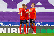0-1 Luton Town midfielder Jordan Clark (18) scores and celebrates during the EFL Cup match between Reading and Luton Town at the Madejski Stadium, Reading, England on 15 September 2020.