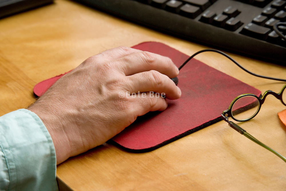 close up of male hand holding a computer mouse