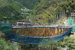 Erection of precast concrete deck units at Yamashiro Bridge in Shikoku Japan