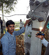 I'm a human lightbulb! The 16-year-old 'electric boy' from India can withstand shocking 11,000 volts without feeling a thing <br /> <br /> It's enough to make your hair stand on end.<br /> An Indian teenager has told how he can withstand 11,000 volts passing through his body - and only discovered his bizarre talent by accident when he was repairing his mother's heater.<br /> Human electricity insulator Deepak Jangra can apparently resist the same amount of voltage required to power 500 houses and even sit with his hands inside a tub of water along with naked live wires.<br /> The 16-year-old claims: 'I have a gift from God. I feel very privileged. I have the power to do things no-one else can and I don't intend on wasting it.<br /> 'I used to be scared of electricity but now I am confident. I have tested myself over and over again and I will never get hurt. I can touch a live wire with my tongue and I know nothing will happen to me.' <br /> <br /> Deepak, who is a student, first discovered that he can resist such high levels of electricity three years ago when he was fixing his mother's portable heater.<br /> He revealed: 'My mother kept complaining that our heater was broken so I thought I'd take a look and try and fix it myself because we couldn't afford to take it anywhere and pay someone to fix it.<br /> 'I accidentally touched the live wire with my screwdriver but nothing happened - I didn't get a shock. But at the time I assumed we must have had a power failure in our village.'<br /> <br /> Two weeks later, Deepak got a movie stuck inside his DVD player and decided to take the machine apart to attempt to retrieve the disc.<br /> 'I hit the live wires again but again nothing happened,' he said. <br /> 'This time I knew something amazing had just happened. I touched it again and again, and then went outside to check the power supply was ok.<br /> 'That was the day I realised there was something unusual about me.'<br /> <br /> Since that moment, Deepak has been e