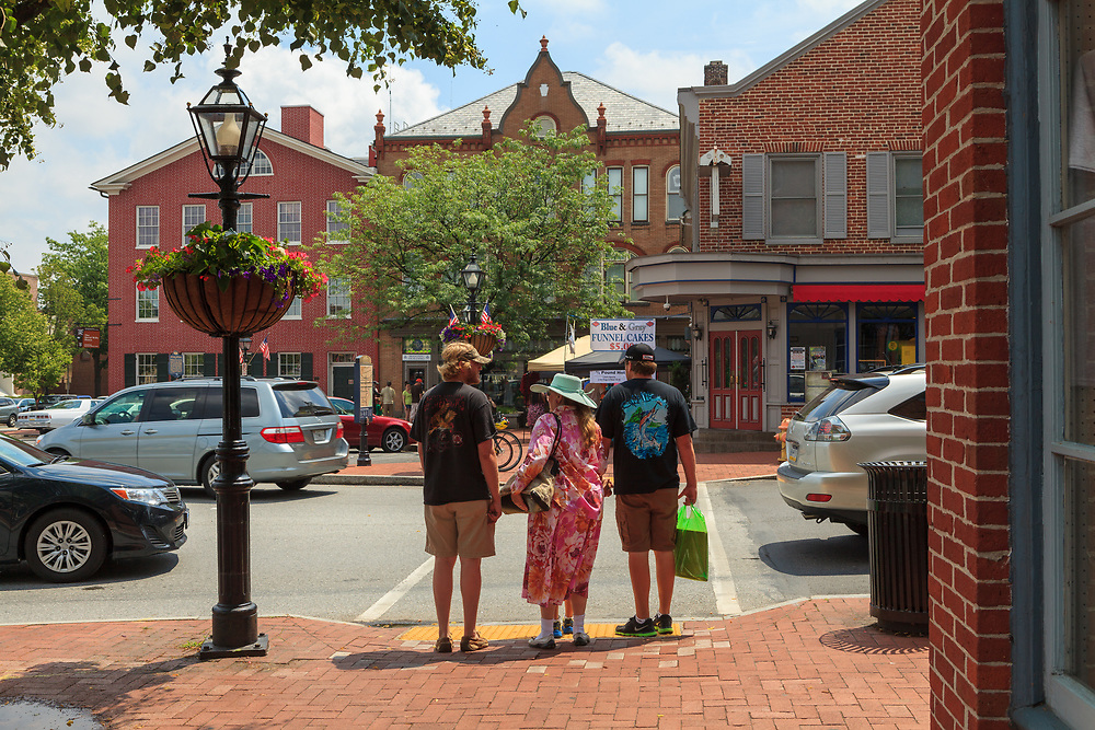 Gettysburg, PA, USA - June 30, 2013:  People walking in Lincoln Square, located in the center of the downtown area of town.