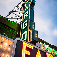Photo of Fargo Theater marquee sign at night in Fargo, North Dakota. The Fargo Theatre was built in 1926 and is on the National Register of Historic Places. The Fargo Theatre is currently a popular venue for films, movies, concerts, plays and other live events. Photo is vertical and was taken in 2011.