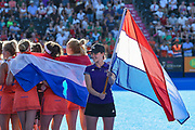 Netherlands flag holder and team draped in their flag during the Vitality Hockey Women's World Cup 2018 Finals Gold Medal match between the Netherlands and Ireland, at the Lee Valley Hockey and Tennis Centre, QE Olympic Park, United Kingdom on 5 August 2018. Picture by Martin Cole.
