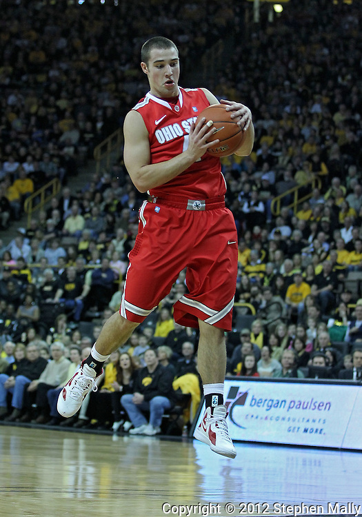 January 07, 2011: Ohio State Buckeyes guard Aaron Craft (4) pulls in a rebound during the the NCAA basketball game between the Ohio State Buckeyes and the Iowa Hawkeyes at Carver-Hawkeye Arena in Iowa City, Iowa on Saturday, January 7, 2012.