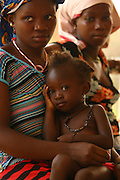 Mariatu Kargbo, 18, with her child Kadiatu, 3, at the therapeutic feeding center of the Magbenthe hospital in Makeni, Sierra Leone on Thursday February 26, 2009. UNICEF sponsored some of the construction of the hospital facilities, and also provides high-protein biscuits and milk as part of a joint effort with the World Food Programme...