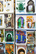 Postcard artwork stand, Asilah, Northern Morocco, 2015-08-10.
