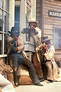 Stuntmen engaged in mock gunfight, Old Tucson Studios, Tucson Mountain Park, Tucson, Arizona. (Must credit Edward McCain / Old Tucson Studios)..McCain Photography Job #00095.Images created April 30, 1986..Rights & Usage:.No rights granted. Subject photograph(s) are copyrighted by ©1986 Edward McCain/McCain Photography. All rights are reserved except those specifically granted by this invoice...McCain Photography.211 S 4th Avenue.Tucson, AZ 85701-2103.(520) 623-1998.mobile: (520) 990-0999.fax: (520) 623-1190.http://www.mccainphoto.com.edward@mccainphoto.com