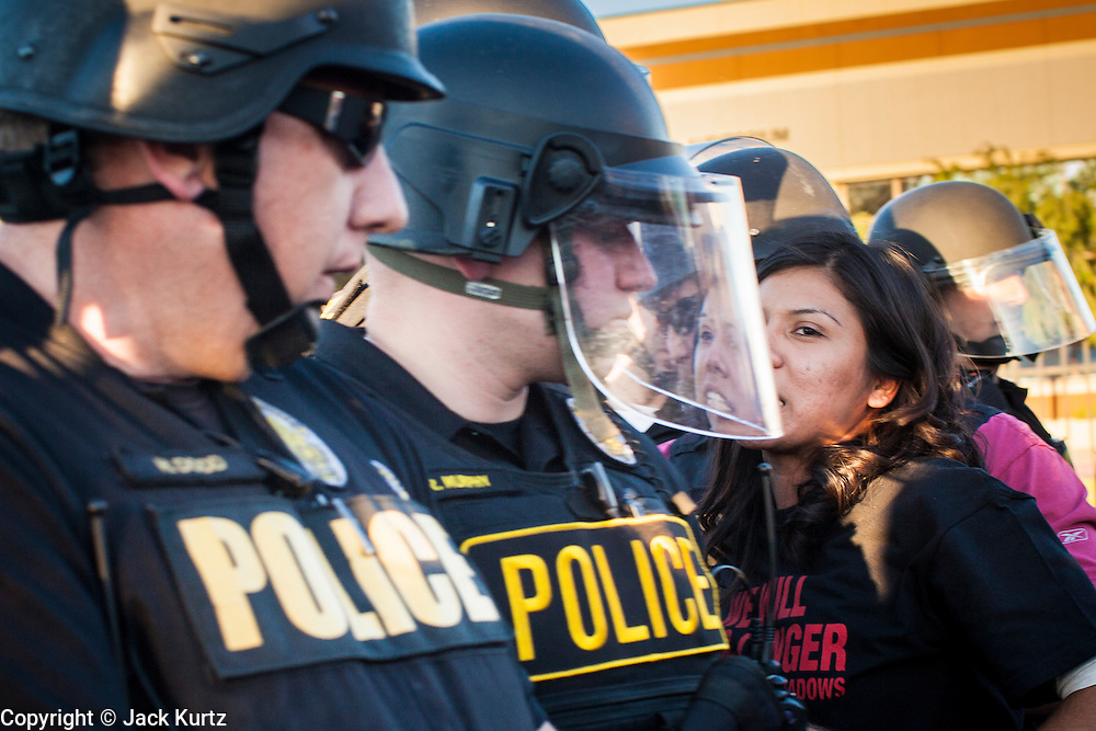20 MARCH 2012 - PHOENIX, AZ: Phoenix arrest a high school student during a student protest in support of the DREAM Act on 75th Ave in front of Trevor G. Browne High School Tuesday.  PHOTO BY JACK KURTZ