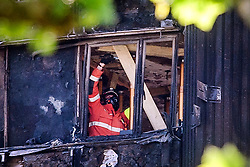 19/06/2017. London, UK. Re-enforcement work being carried out to levels of the Grenfell Tower Block which was severely damaged in a fire last week.  The blaze engulfed the 27-storey building killing dozens - with dozens of people still in hospital, many of whom are in critical condition. Photo credit: Ben Cawthra *** Please Use Credit from Credit Field ***