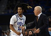 Nov 15, 2019; Los Angeles, CA, USA; UCLA Bruins head coach Mick Cronin talks with guard Prince Ali (23)  in the second half against the UNLV Rebels at Pauley Pavilion. UCLA defeated UNLV 71-54.