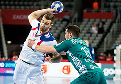 Stefan Vujic of Serbia vs Artur Karvatski of Belarus during handball match between National teams of Serbia and Belarus on Day 7 in Main Round of Men's EHF EURO 2018, on January 24, 2018 in Arena Zagreb, Zagreb, Croatia.  Photo by Vid Ponikvar / Sportida