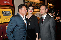 Left to right, ANDRE BALAZS, ANNE HATHAWAY and ADAM SHULMAN at a party to celebrate the launch of the Maison Assouline Flagship Store at 196a Piccadilly, London on 28th October 2014.  During the evening Valentino signed copies of his new book - At The Emperor's Table.