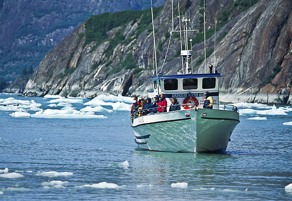 Tour boat Adventure Bound Alaska carries a group of tourist into Tracy Arm.  Southeast Alaska.