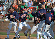 Milton runner Andrew Wood (4) celebrates with Sean Ryan Brophy (14) and his teammates after he scores the go-ahead run in the eighth inning against Roswell in their GHSA AAAAAA State Baseball Championship game, Monday, May 27, 2013, in Milton, Ga.   David Tulis/dtulis@gmail.com