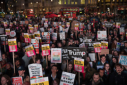 © Licensed to London News Pictures. 20/02/2017. London, UK . Protestors listen to speeches as they gather in Parliament Square as MPs debate petitions for and against a State Visit by US President Donald Trump . Photo credit: Peter Macdiarmid/LNP