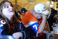 At the Pizza Factory in Salinas, Bronco fans Shawna and Bobby Valenzuela react to a Seahawk advantage during the first half of Sunday's Super Bowl matchup.
