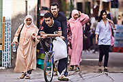 men on bike in marrakech.