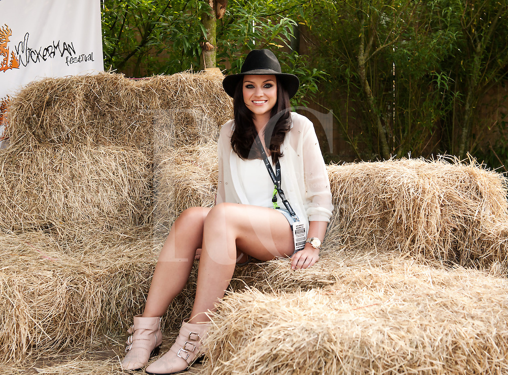 DUNDRENNAN, UNITED KINGDOM - JULY 27: Amy Macdonald poses backstage on Day 2 of Wickerman Festival on July 27, 2013 in Dundrennan, Scotland. (Photo by Ross Gilmore