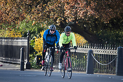© Licensed to London News Pictures. 29/03/2020. London, UK. Two men cycling around Regents Park, London in the early morning sun, during a lockdown over the Coronavirus spread. Members of the public have been told they can only leave their homes to exercise briefly once a day, and to go to shops for essentials when absolutely necessary, in an attempt to fight the spread of COVID-19. Photo credit: Ben Cawthra/LNP