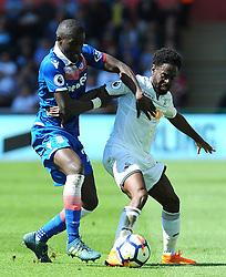 Nathan Dyer of Swansea City battles with Papa Alioune Ndiaye of Stoke City - Mandatory by-line: Nizaam Jones/JMP- 13/05/2018 - FOOTBALL - Liberty Stadium - Swansea, Wales - Swansea City v Stoke City - Premier League