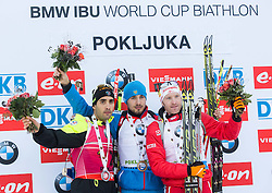 Second placed FOURCADE Martin (FRA), winner SHIPULIN Anton (RUS) and third placed EDER Simon (AUT) celebrate at medal ceremony after the Men 15 km Mass Start at day 4 of IBU Biathlon World Cup 2014/2015 Pokljuka, on December 21, 2014 in Rudno polje, Pokljuka, Slovenia. Photo by Vid Ponikvar / Sportida