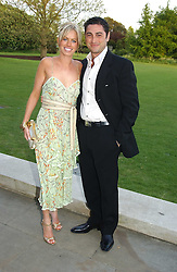 CEM & CAROLINE HABIB at 'Horticouture' a charity fashion show to raise funds for Tommy's, the baby charity and The Royal Botanic Gardens, Kew held at Kew on 12th May 2005.<br />