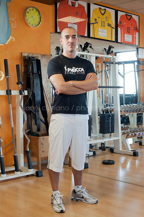 BORGO MAGGIORE, SAN MARNO - 3 OCTOBER 2011: Damiano Vannucci, 34, defender in the San Marino national team, works as a physical instructor in the gym he owns in San Marino, San Marino on October 3, 2011. Damiano Vannucci started working as a physical instructor when he was 21 and has the highest attendance (64 games) in the San Marino national team, whom he's been playing with for 15 years. The San Marino national football team is the last team in the FIFA  World Ranking (position 203). San Marino, whose population reaches 30,000 people, has never won a game since the team was founded in 1988. They have only ever won one game, beating Liechtenstein 1&ndash;0 in a friendly match on 28 April 2004. The Republic of San Marino, an enclave surronded by Italy situated on the eastern side of the Apennine Moutanins, is the oldest consitutional republic of the world<br /> <br /> <br /> ph. Gianni Cipriano