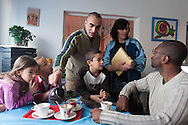 France, La Courneuve , cite of 4000.  Marchand Family, Valerie , Nordine Taraoui and their five children are living in the same area since their birth, Eugene Henri More, ( Black)  is working for the city controled by , comunist and socialist  /  / France, La Courneuve, cite des 4000 , La famille Marchand valerie et Nordine  Taraoui et leurs cinq enfants. Eugene Henri More adjoint au maire   /
