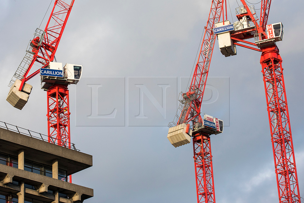 © Licensed to London News Pictures. 16/01/2018. London, UK. Carillion construction cranes at a standstill on a building site in central London. The construction firm has gone into liquidation after losing money on big contracts and running up debts of around £1.5bn. Photo credit: Rob Pinney/LNP
