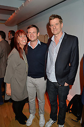 Left to right, MELANIE ROCKCLIFFE, DOMINIC TREDWELL-COLLINS and GRAHAM BROADBENT at a party to celebrate the publication of Holding by Graham Norton held at Liberty, Regent Street, London on 12th October 2016.