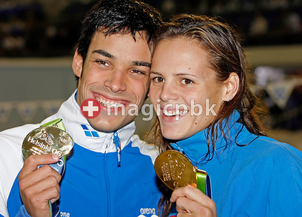 (L-R) Luca Marin of Italy and Laure Manaudou of France, who have been an item for several months, pose with their gold medals after the finals session on day two at the European Short-Course Swimming Championships at the Maekelaenrinne Swimming Centre in Helsinki, Finland, Friday December 8, 2006. Marin won the men's 400m medley final and Manaudou won the women's 800m freestyle and 100m backstroke. (Photo by Patrick B. Kraemer / MAGICPBK)