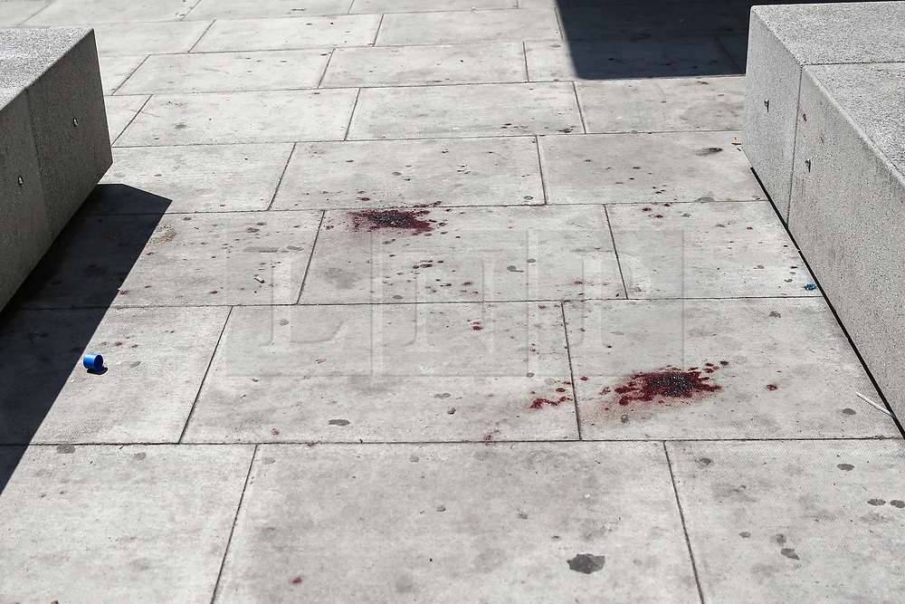 © Licensed to London News Pictures. 28/05/2019. London, UK. London, UK. Blood is seen on Romford Road (opposite Warwick Road), Forest Gate in East London where a man in his 30s died in the early hours of this morning following a fight on Warwick Road.<br /> Police officers were called after the victim was found suffering from stab injuries and he died later in the hospital. Photo credit: Dinendra Haria/LNP CAPTION UPDATED WITH CORRECT DATE