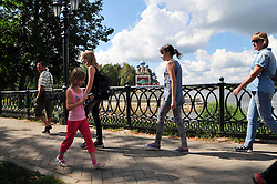 "Pedestrians ply the elegant riverside walkways along the Volga in Uglich, Russia. The colorful onion domes of the church of Saint Dimitry on the Blood, built in 1690, are in the background. As one of Russia's ""Golden Ring"" cities, Uglich is designated a town of significant cultural importance."