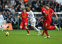 Sunday, 25 November 2012..Pictured: Jonathan de Guzman of Swansea (2nd L) against L-R Joe Allen, Glen Johnson and Steven Gerrard of Liverpool..Re: Barclays Premier League, Swansea City FC v Liverpool at the Liberty Stadium, south Wales.