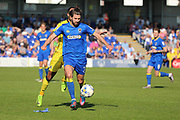 AFC Wimbledon defender George Francomb (7) holding up the ball from Bristol Rovers striker Byron Moore (22) during the EFL Sky Bet League 1 match between AFC Wimbledon and Bristol Rovers at the Cherry Red Records Stadium, Kingston, England on 8 April 2017. Photo by Matthew Redman.