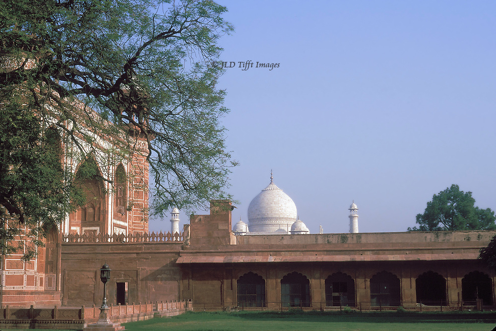 Approaching the Taj Mahal enclosure, the dome visible over the enclosure wall.