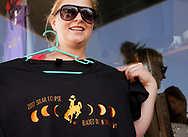 Melissa Howe displays one of her eclipse t-shirts designs in Guernsey, Wyoming U.S. August 19, 2017.  REUTERS/Rick Wilking