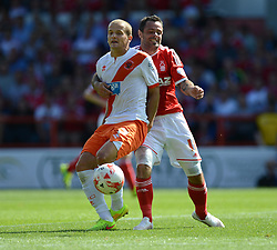 BlackPool's Tom Asz Cywka  battles for the ball with Nottingham Forest's Andy Reid - Photo mandatory by-line: Alex James/JMP - Mobile: 07966 386802 09/08/2014 - SPORT - FOOTBALL - Nottingham - City Ground - Nottingham Forest v Blackpool - Sky Bet Championship - First game of the season