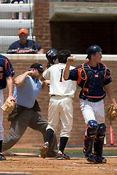 Oregon State Beavers IF Joey Wong (1) is called out at the plate after a tag by Virginia Cavaliers catcher Beau Seabury (16).  The Oregon State Beavers defeated the Virginia Cavaliers 7-3 in Game 7 of the NCAA World Series Charlottesville Regional held at Davenport Field in Charlottesville, VA on June 5, 2007.  With the win, the Beavers advance to the NCAA Super Regional.