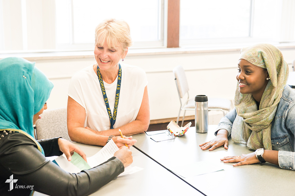 Dr. Nancy Harrower, assistant professor and chair of  Marketing Management, assists students with class schedules at Concordia University, Saint Paul, on Wednesday, August 6, 2014, in St. Paul, Minn.   LCMS Communications/Erik M. Lunsford