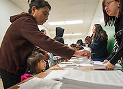 Parents sign in before a PowerUp meeting at Austin High School, November 7, 2013.