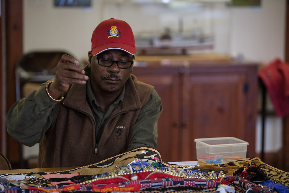 Shady Side, Maryland, US - 21 September 2009. Vincent Leggett works on a quilt pieced from memorabilia of black watermen at the Salem Avery Museum in Shady Side, Maryland.