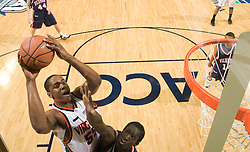 Virginia forward/center Jerome Meyinsse (55) shoots against Richmond.  The Virginia Cavaliers men's basketball team defeated the Richmond Spiders 66-64 in the first round of the College Basketball Invitational (CBI) tournament held at the University of Virginia's John Paul Jones Arena in Charlottesville, VA on March 18, 2008.