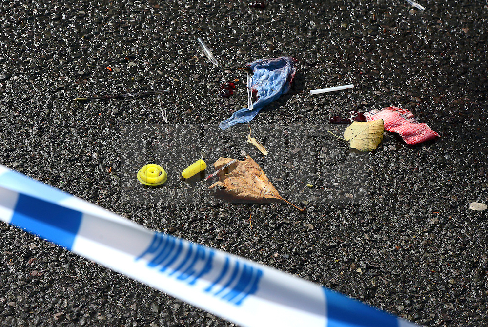 © Licensed to London News Pictures. 30/08/2012. London, UK A blood stained bandage at the scene where the victim was treated. A street cleaner has suffered potentially life threatening after being stabbed when disturbing a burglary in Shepherds Bush in West London today 30 August 2012. Photo credit : Stephen Simpson/LNP