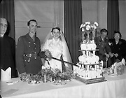 18/11/1952<br /> 11/18/1952<br /> 18 November 1952<br /> Wedding of Lieutenant Seamus Lillis, (son of Colonel James Lillis, Army Chief of Staff) Collins Barracks, Cork and Miss Aureed Mundy, Donegal at Ross Nuala and Bundoran, Co. Donegal. The couple cut the cake with Lt. Lillis' dress sword. On left is the Bride's uncle Most Rev. Dr.   William MacNeely, Bishop of Raphoe.